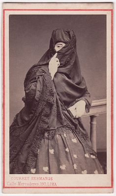 "Una tapada limeña by Beniah Brawn. Women, full of grace and beauty, were known universally by the name of ""la tapada limeña"", because of their celebrated attire, ""la saya y el manto"" . This attire consisted on a black skirt and a cloak that women would hold gracefully over their face, coquettishly leaving one eye uncovered. Such original attire allowed ""las limeñas"" to go out alone and to start a conversation with whomever they pleased, without damaging their dignity. specific to Lima"