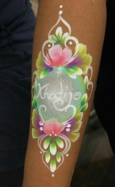 Floral arm name face paint by br