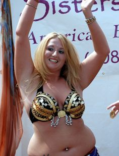 Beautiful, curvaceous, free spirited woman... belly dancing for the joy of it while others just wish they had the self confidence to try.  If you feel the hand drum rhythm.... dance. Your soul has no age, no weight and no fear.