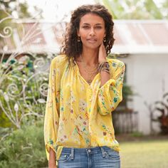 MEGANS SWEET WILLIAM BLOUSE -- Your favorite, feminine silhouette is irresistible in the season's prettiest print on silk crinkle chiffon. Smocked neckline, elasticized three-quarter sleeves, natural shell buttons. Dry clean. Imported. Exclusive. Sizes XS (2), S (4 to 6), M (8 to 10), L (12 to 14), XL (16). Approx. 25-1/2L.