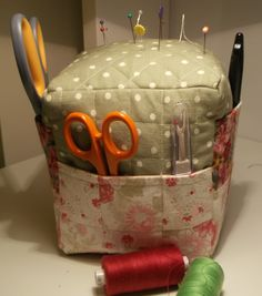 A large pincushion with pockets from a pattern by http://bluepatchquilter.blogspot.co.uk/