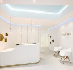 Gorgeous reception area in white gold and blue Refined Elegance Meets Functional Style At Dental Angels In Barcelona