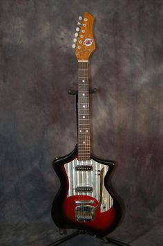 Today, Lawman Guitars is Presenting...A Vintage and RARE 1960's Made in Japan Teisco Del Ray Swinger Guitar..The Teisco Swingers with the cutaway body style are pretty rare. I have sold 1/2 dozen over the years and have never had one with the whammy and dual Pickups. Give us a call. Lawman Guitars. 515-864-6136