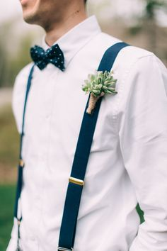 Succulent boutonniere + navy suspenders: http://www.stylemepretty.com/2016/05/09/dapper-and-dandy-groom-suspender-style/