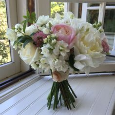 June wedding bouquet of peonies, roses, mock orange, stock and vintage cameo, Designed by Alison Ellis of Floral Artistry.