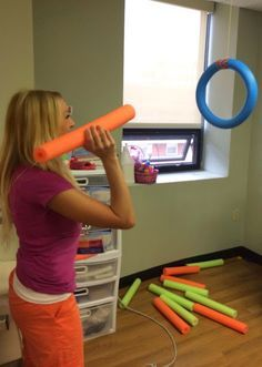 This fun noodle activity incorporates motor planning abilities to throw a noodle through a circular noodle. Hand eye coordination is involved to accurately get the noodle through the ring.
