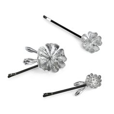 Keep your hairstyle firm and beautiful with the sterling silver Julieta hair slide. The beautiful blossom flowers make this piece the perfect accent to any bride's head no matter which style her dress may be, classic or contemporary.