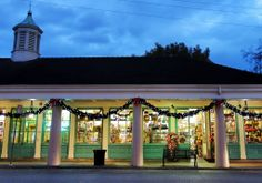 Stroll along the French Market adorned with garlands and lights for the holidays