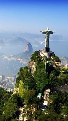Statue of Jesus Christ overlooking the City of Rio de Janeiro, Brazil, with Sugarloaf Mountain at the mouth of the bay