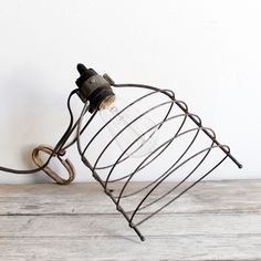 vintage industrial clip on cage lamp. 34.00, via Etsy.