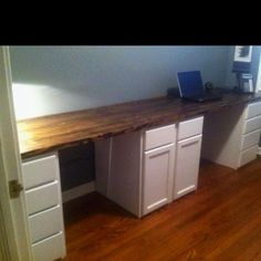 His and hers desk we built this past weekend.  Unfinished kitchen cabinets make a great base and provide tons of storage!