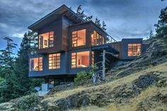 We are lucky to have worked on many awesome custom home projects on the island over the years. Learn more about our Ash Mountain project here! Custom Home Builders, Custom Homes, Corten Steel, Polished Concrete, Stunning View, Concrete Floors, Home Projects, Luxury Homes, Ash