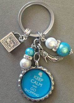 This listing is for one KEEP CALM and GO SHOPPING bottle cap key chain.  This key chain is a must if you love shopping!! The key chain has an adorable purse charm (plain purse with no writing on it) and a high heel shoe. It is decorated with pearl like beads and turquoise beads.   You may cho...