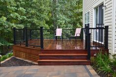 Client wanted to create a more usable backyard. We removed her existing deck and replaced with a larger Tigerwood deck with Fiberon Inspiration black rail system and cedar lattice. The patio was constructed using Belgard Hardscapes Grana slab in Bella blend with a Laffit border in Bella blend and Holland Stone in Charcoal blend. Steps were made from Belgard Belair wall in Delaware blend. Project completed with lighting and plantings. Outdoor Living, Outdoor Decor, Holland, Exotic, Construction, Backyard, Delaware, Decks, Larger