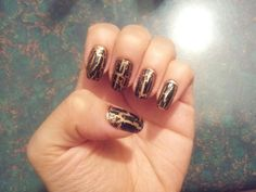 Gold base with black crackel nails
