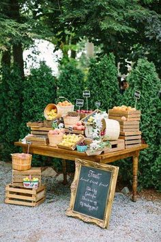 A bounty of fresh fruits displayed in wooden slate crates, bushels ontop of an antique pine harvest table. www.happilyeveraftereventsinc.ca