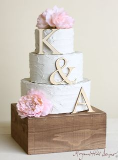 This would look pretty with the little gnomes on top! Personalized Wedding Cake Topper Wood Initials by braggingbags