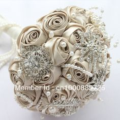 Holding champagne wedding flower brooch bouquet includes a bridegroom boutonniere wrist flowers $220.00