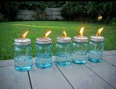 ✿✿ BACKYARD FUN~WITHOUT THE BUGS ✿✿ There was some discussion a while back on getting rid of mosquitoes. While there's lots of products out there, here's one way to do it, have a stylish yard and keep the costs down too. All you need is a pack of mason jars, some cotton string and some liquid citronella (find it in large jugs at any home-improvement store and even some grocery stores) Use a hammer and nail to poke a hole in the top of the lid, pour the citronella in the jar, replace the lid…