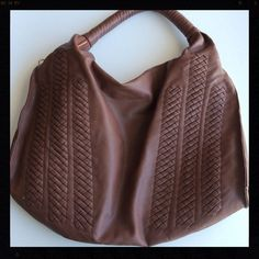 Trendy Brown Vegan Leather Shoulder Bag This trendy brown bag is perfect for any season! It is absolutely gorgeous and has a place on each side of the bag to attach a longer strap to wear cross body. Does not come with longer strap. There is a small pen mark on the inside of the bag. Bags Shoulder Bags