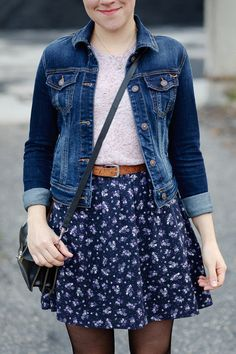 floral mini skirt with a pink tee and denim jacket and black tights