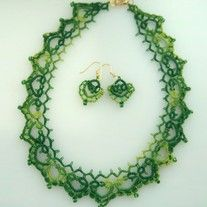 Elegance and grace describe this lace tatted necklace. Its delicate design will beautifully frame any neck. It is made of fine cotton thread and small metallic green beads and fastens with a gold lobster clasp.    Sold