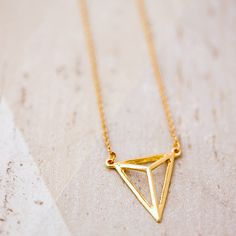 J&S Jewellery Geometric Triangle Necklace ($20) ❤ liked on Polyvore featuring jewelry, necklaces, yellow gold necklace, geometric jewelry, triangle necklace, gold triangle necklace and gold geometric necklace
