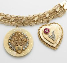 A cultured pearl, ruby, diamond and 14k gold charm bracelet