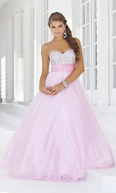 I don't really like looking at prom dresses, but this one is amazing! I love how the top is sparkle and then it just a nice flow down to the bottom. The hair and earring add a perfect touch, and I think sparkle heels would look good with this.