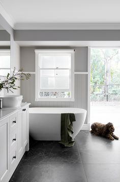 Queenslander bathroom with grey VJ wall panelling and shaker style cabinetry.
