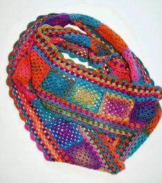 No pattern, but inspiration. Looks like a bunch of granny squares with a granny stripe border. Very pretty colors.
