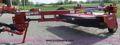 2012 New Holland H7230 Discbine windrower | Item J4144 selling at Wednesday May 11 Ag Equipment Auction | Purple Wave, Inc.