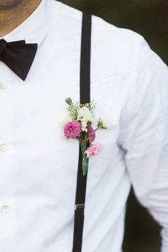 #Boutonniere pinned to Suspenders - Cute! See the wedding on SMP -  http://www.StyleMePretty.com/2014/01/13/diy-backyard-oregon-wedding/ Anna Jaye Photography