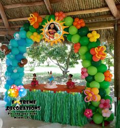 Princess Moana theme Birthday party decorations. Cake table with balloon arch with Hawaiian theme. Luau birthday party ideas. Extreme Decorations Ph: 786-663-8198 www.extremedecorations.com