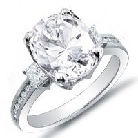 A perfect ring for someone who wants something different from the rest! This impressive 2.08 Ct. diamond engagement ring contains a 1.22 Ct. Oval cut center diamond EGL certified G color grade and very clean VS2 clarity. Dazzling 0.50 Ct. Princess cut diamonds flank each side of the center stone while 0.36 Ct. Round cut diamonds line the shank in channel set. These 0.86 Ct. side diamonds have F-G color grade and VS1-VS2 clarity to complement the center diamond for a unified look. This high…