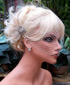 Ivory bridal hair fascinator and french net veil, vintage style brooch, feather fascinator -ship ready OOAK. $68.00, via Etsy.