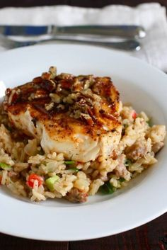 Cajun Halibut with Praline Sauce and Dirty Rice from Compean Serve with roaster broccoli. easily modify for Use andouille sausage for the dirty rice (not authentic but so good.) The halibut and sauce are fantastic! Cajun Recipes, Fish Recipes, Seafood Recipes, Great Recipes, Cooking Recipes, Favorite Recipes, Healthy Recipes, Cajun Food, Halibut Recipes