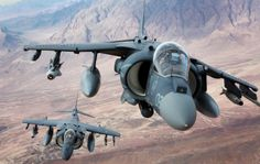 Capt. Jonathan Lewenthal and Capt. Eric Scheibe, AV-8B Harrier pilots with Marine Attack Squadron 231, Marine Aircraft Group 14, 3rd Marine Aircraft Wing (Forward), fly over southern Helmand province