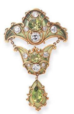 A FINE ART NOUVEAU PERIDOT, DIAMOND AND ENAMEL BROOCH, BY MARCUS CO. Designed as a green plique-à-jour enamel plaque, centering upon an oval-cut peridot, enhanced by old European-cut diamond collet and textured gold trim, suspending a smaller plaque of similar design, to the drop-shaped pendant, set with a pear-shaped peridot and textured gold scroll motifs, mounted in gold, circa 1900 Signed Marcus Co.