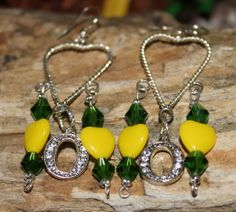 Oregon Ducks Chandelier Earrings with yellow heart beads and green crystal faced bicone beads.  Available at www.etsy.com/shop/sparklesjd