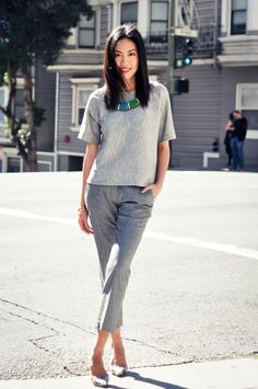 Tonal greys paired with a bold and bright necklace is a perfectly-seriously-stylish workwear combination.