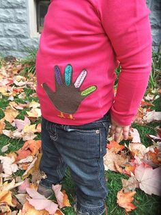Use your child's handprint to make a turkey shirt!