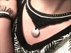 Items similar to Design black and white Macrame Necklace with a metal pendant on Etsy