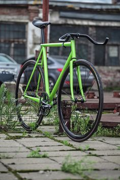 Lime fixie. Built light and simple... my type of bike.