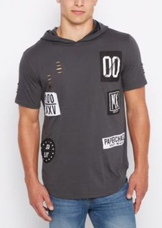 Not your average t shirt. This trendy hoodie tee comes in soft jersey and features stitched patches across the chest and stylized rips for a relaxed, edgy feel. A modern longer length keeps the look fresh.