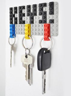 "LEGO DIY Key Hanger. So at first I was looking at this and I thought, ""Gosh, that isn't very practical. Who wants to take the time to put the keys on the rings every time you come home."" Then I had the ah-ha moment of, ""Duh! The legos are the key chain. You snap them on when you get home"" This IS awesome!"