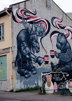 Wall painting by Finnish artist Jukka Hakanen: Finland (the elk) and Russia (the bear) having coffee.
