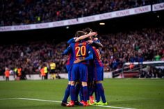 Players of FC Barcelona celebrate after their teammate Aleix Vidal scored their team's third goal during the La Liga match between FC Barcelona and Athletic Club at Camp Nou  stadium on February 4, 2017 in Barcelona, Catalonia.