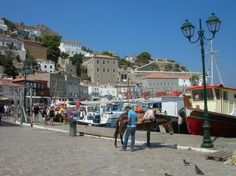 """Here is a great view of the main port and shopping area on the island of Hydra,Greece. During my 3 weeks in this Aegean paradise..the weather was perfect daily. The warm sea waters felt therapeutic. Also..no cars nor motor vehicles are permitted..so donkeys,horses & mules transport items,people and luggage.Great restaurants & hotels & beaches. Hydra (pronounced """"EE-druh"""") is a destination worth considering.  See my photos. from Greece.view slideshow 'Full Screen'. Click this photo:"""