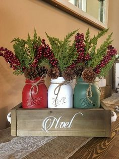 This is a perfect way to ring in the holiday season with this rustic Christmas centerpiece. Dimensions: 12.75x5.5 Quart sized jars Package includes: (1) planter box (dark walnut) with hand painted stencil (3) christmas chalk painted mason jars (3) flowers I can make any size youd